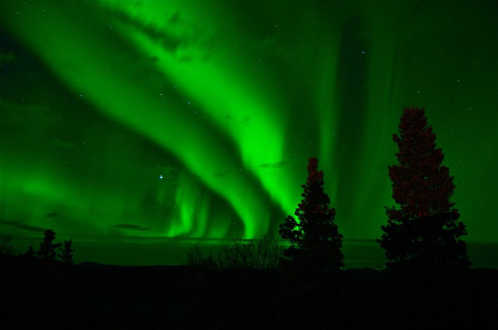 Aurora Borealis lights over nightime sky