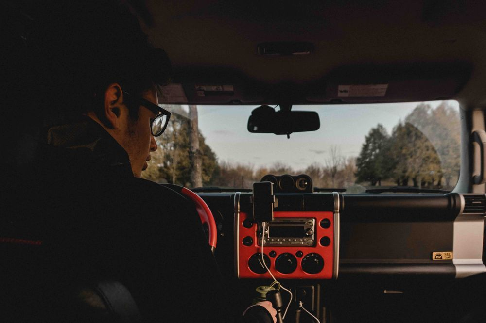 Man listening to radio in his car, Canada