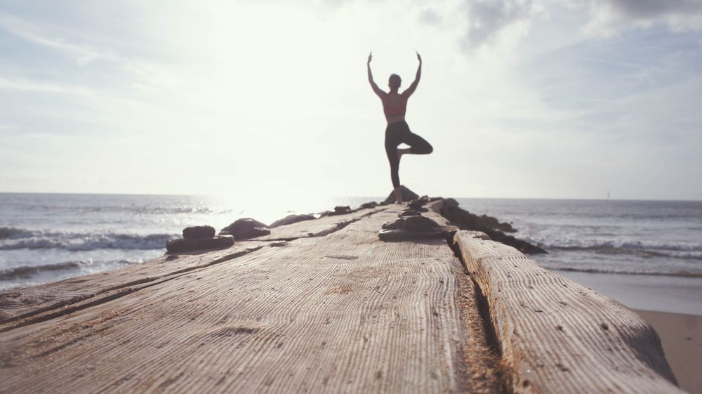 A woman exercising on beach front