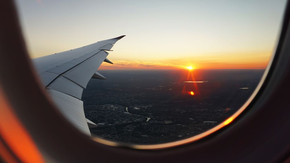 Beutiful sunset pictured from inside a descending airplane