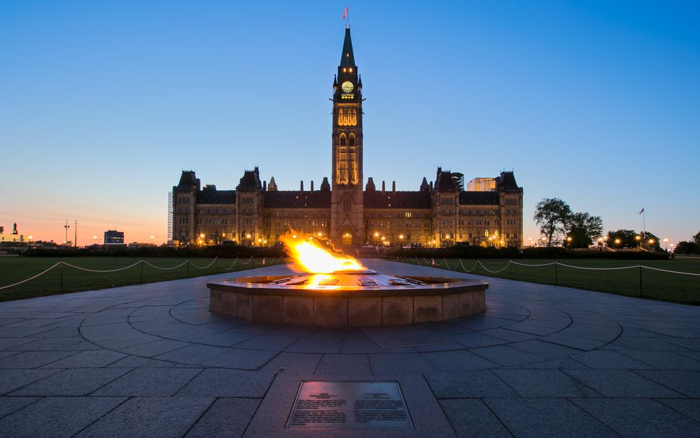 parliament hills lights up the night sky in ottawa