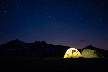 tents at night with starry sky