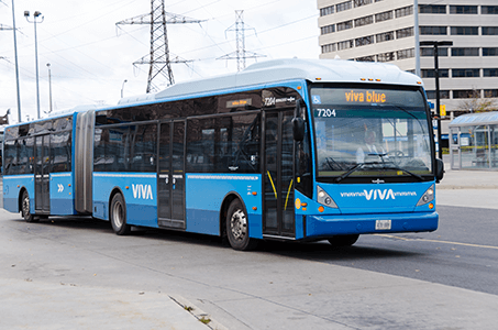 Viva bus taking off from station