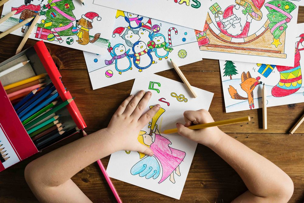 child coloring in picture book