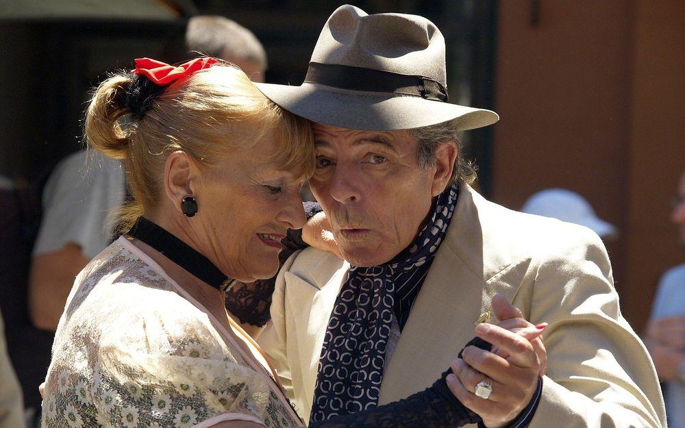 Elderly couple dancing under the sun