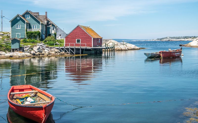 Atlantic Canada boat on ocean with boat house  |  work in Canada