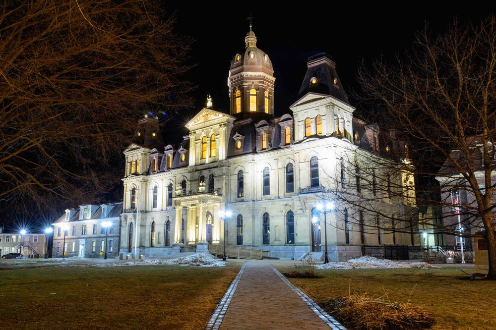 The New Brunswick Legislative Assembly building at night. Photo by Jason Jeandron.