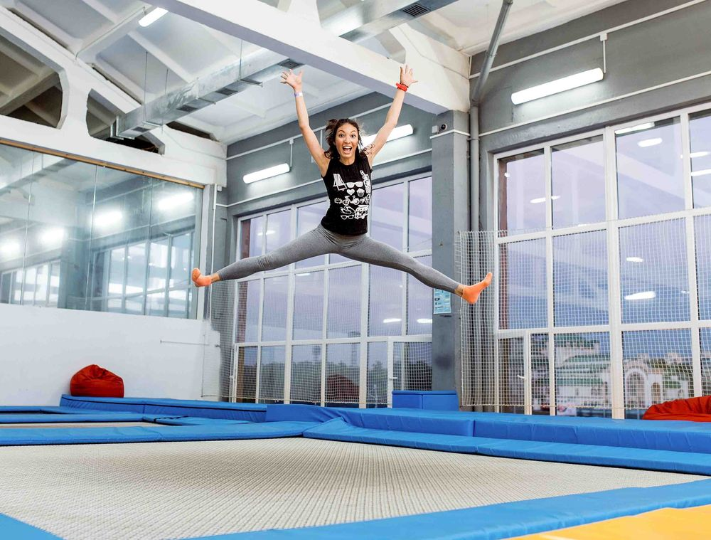 Girl jump high on trampoline
