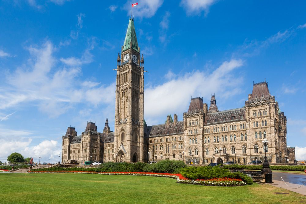 Parliament hill buildings with pristine lawns in ottawa canada