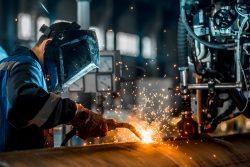 Welders welding in Canada