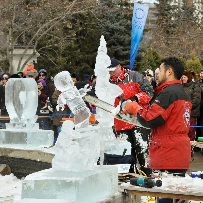 Men working on ice sculpures during the winterlude festival
