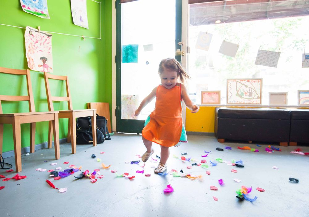 happy child playing in classroom