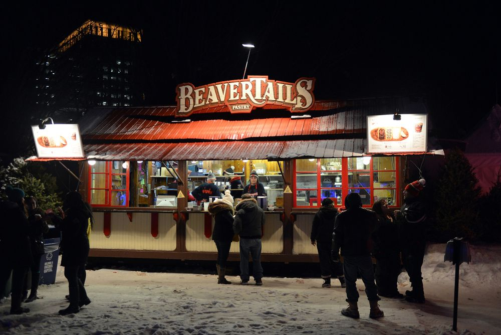 A busy pastry restaurant serving customers on a cold icy night