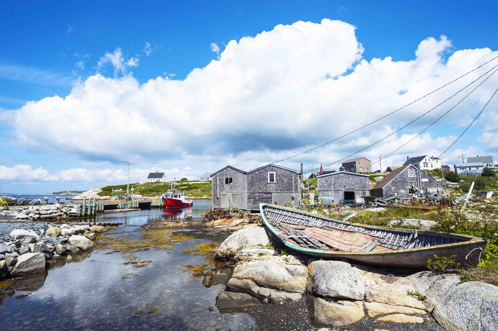 Old fishing boat on the rocky shore of the fishing village Peggy's Cove