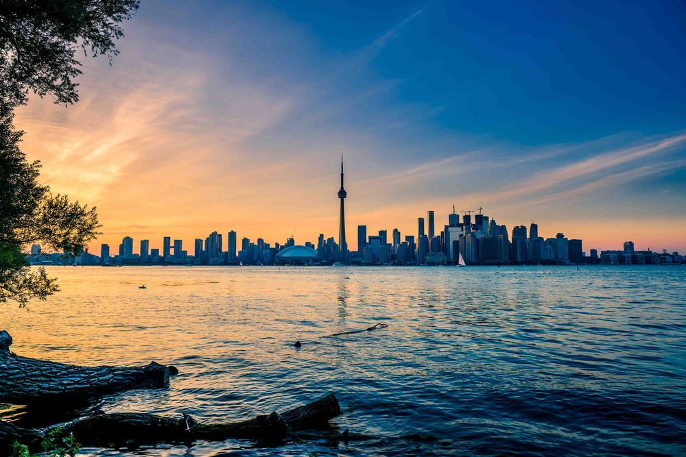 A view of the sun setting on the city of Toronto from the main Toronto Island