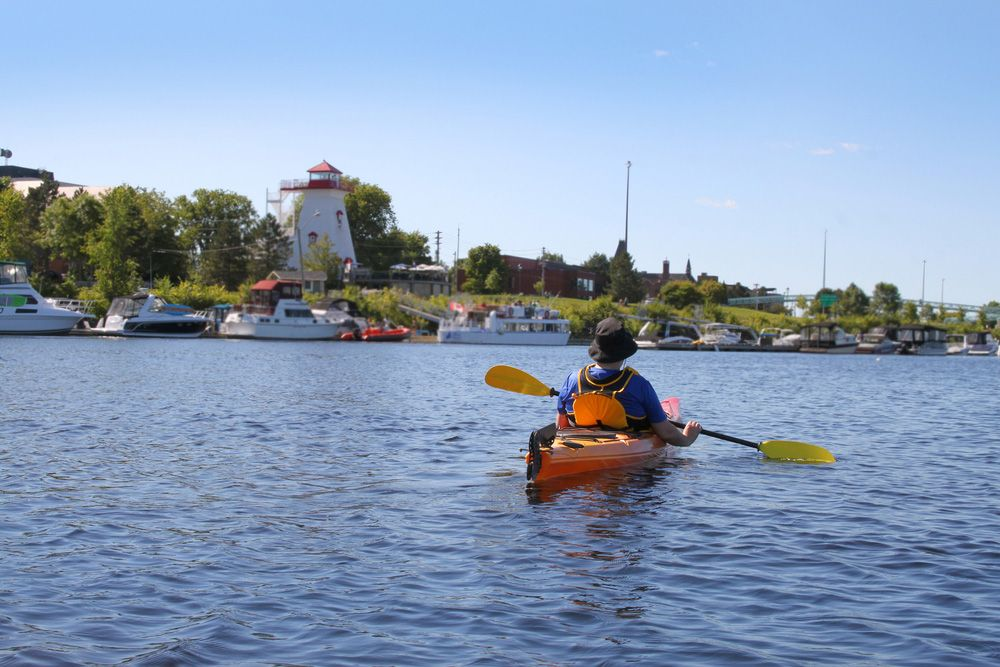 Man kayaking on the Saint John River near downtown Fredericton.