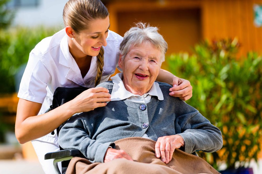 young nurse helping an elderly woman