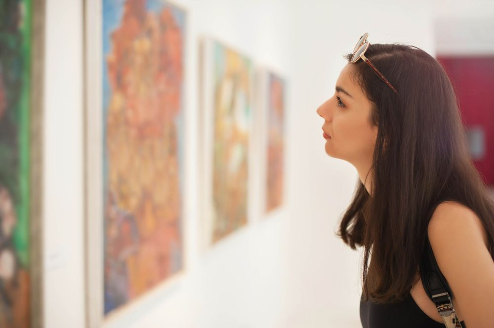 Woman looking at art piece at local gallery Canada