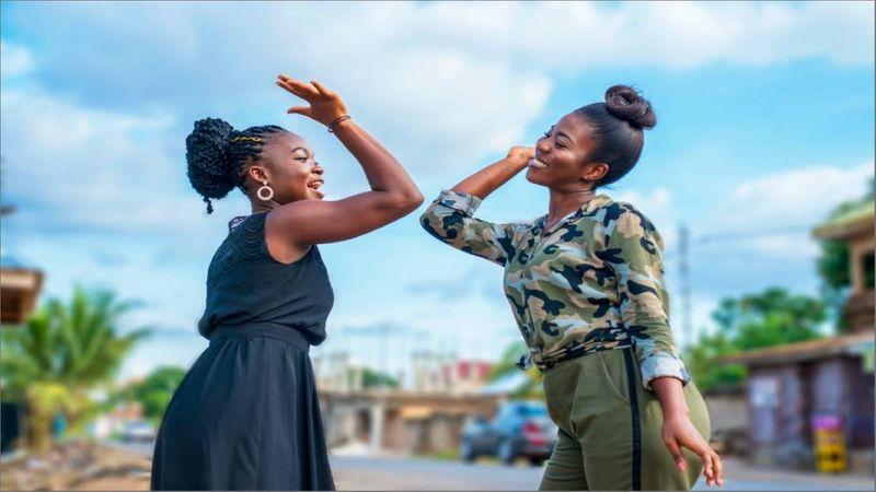 Two beautiful black women/friends having fun
