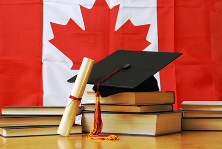 Canadian flag with graduation hat and books