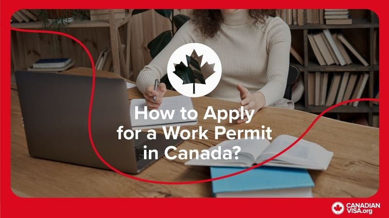 Woman sitting at desk_banner _image_how_to_apply_for_a_work_permit
