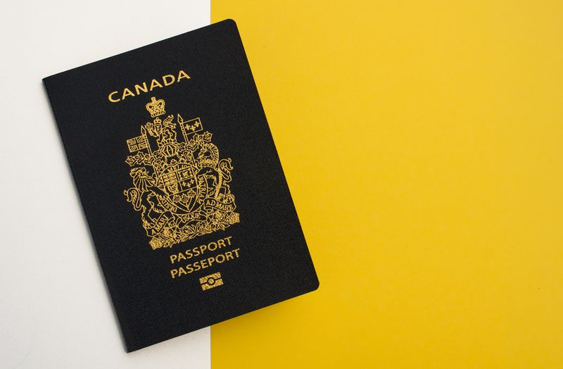 Canada passport on yellow and white background | immigrate to Canada