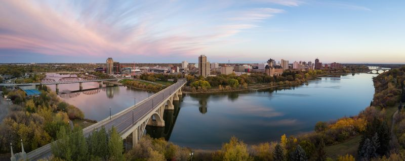 Aerial panoramic view of bridge over Saskatchewan River at sunset in Saskatoon Canada