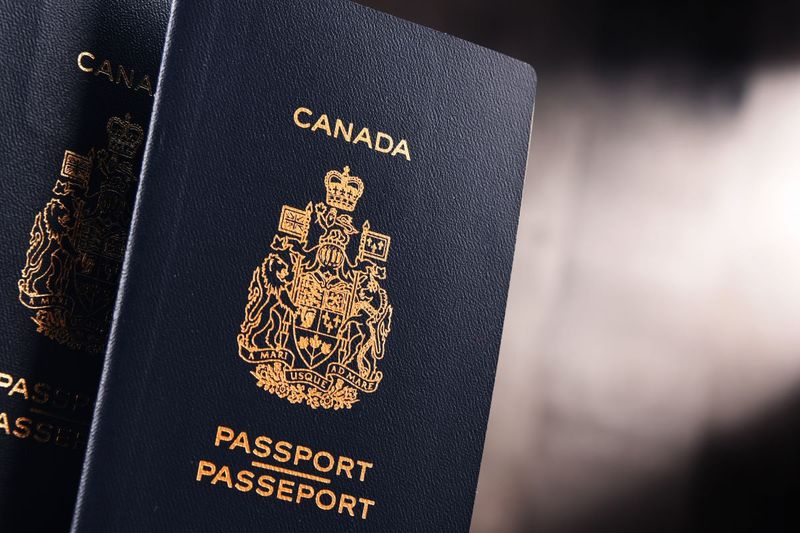 Canadian passport blur gray background | move to Canada