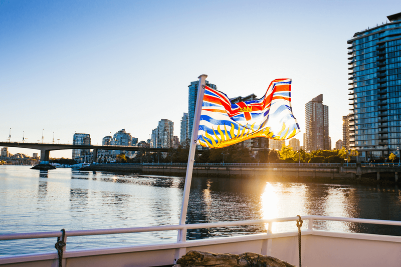 british columbia flag over water in Vancouver