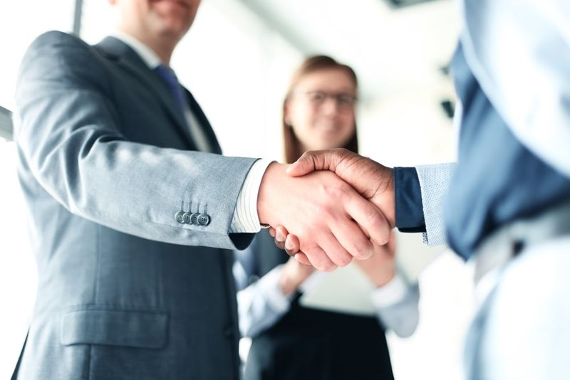 Canadian business people shaking hands
