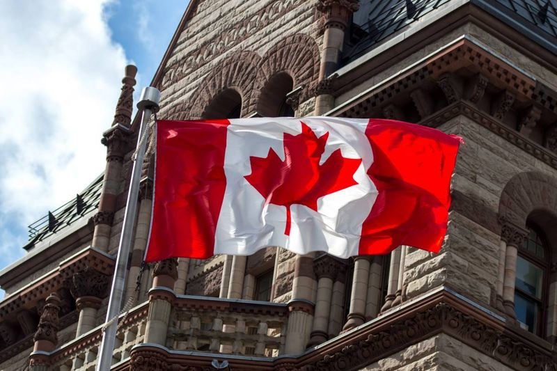Canada flag building immigrate to Canada