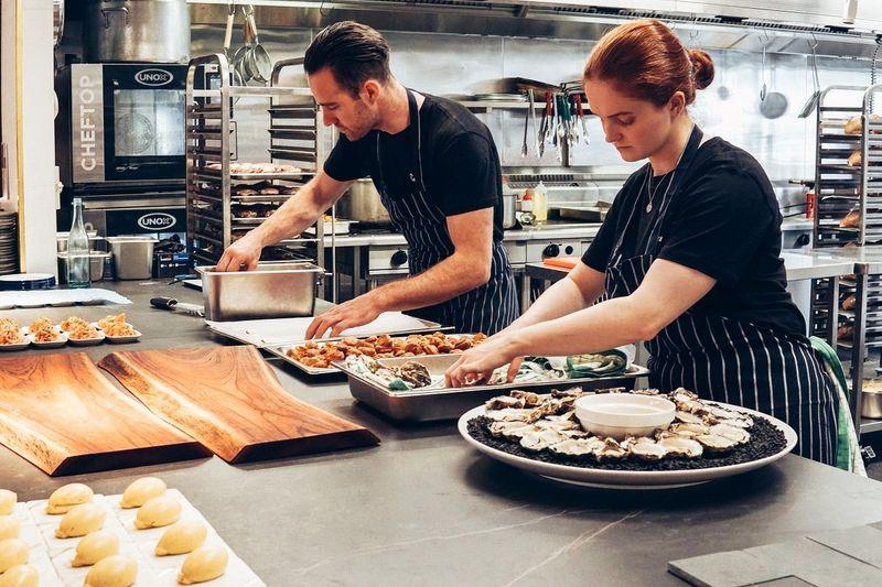 Chefs preparing platters
