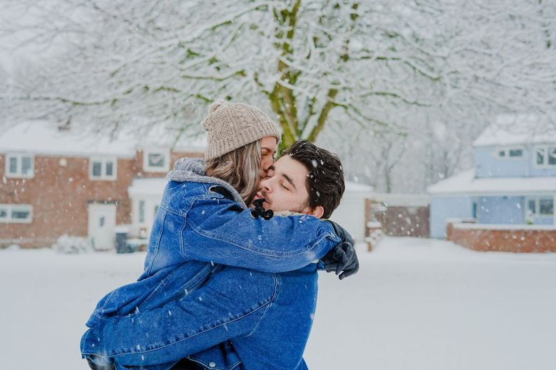 Sweet couple playing the snow