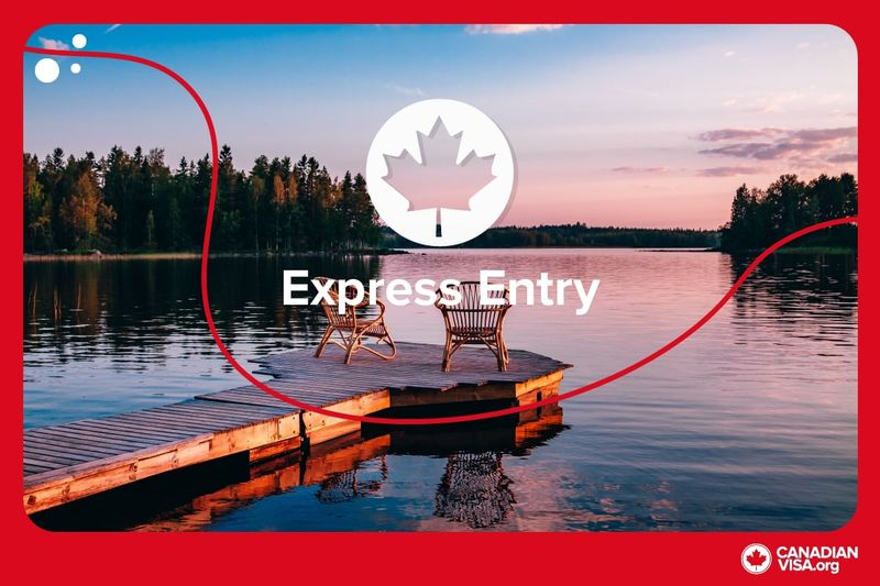 wooden deck with chairs over looking lake | Canada Express Entry