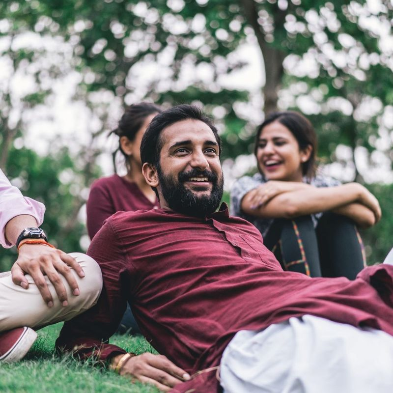 Happy Indian with his family in a park