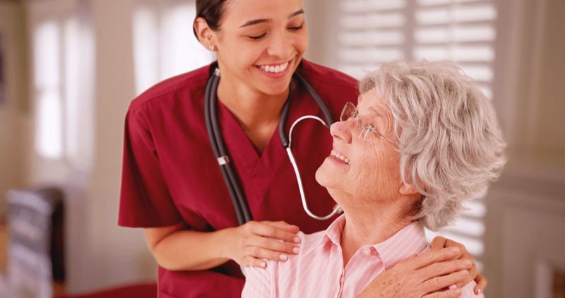 Hispanic nurse looking after senior patient