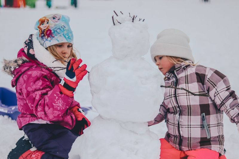 Kids building a snowman