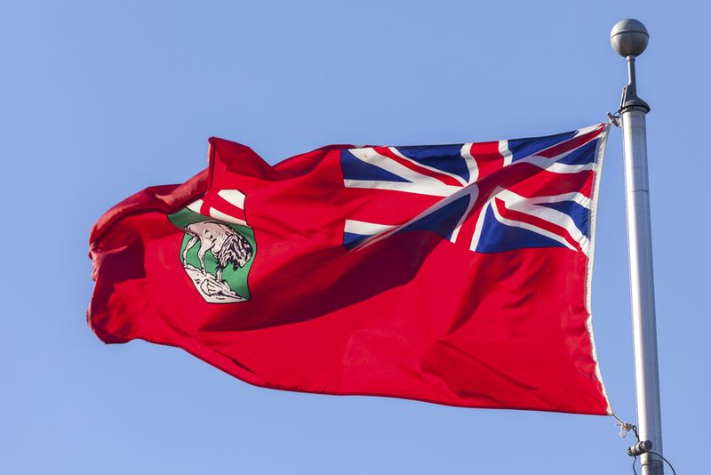 Manitoba Immigration waves its flag high.