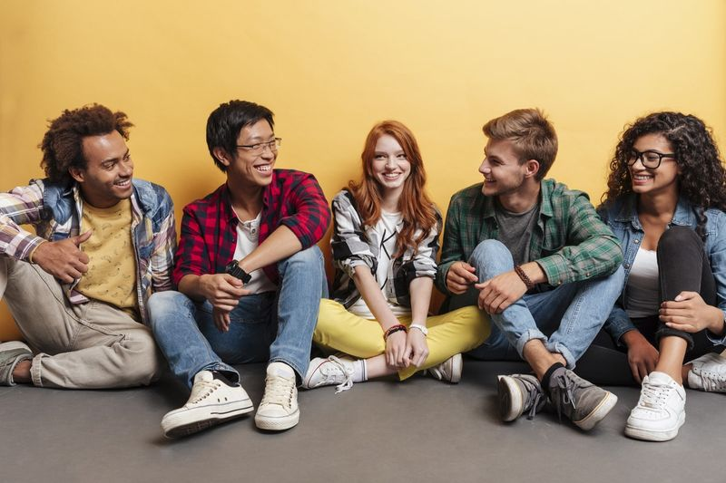 multi ethnic groups of university students chatting