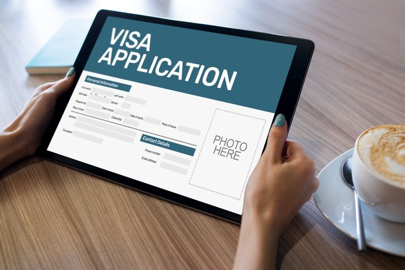 Online Skilled Worker Visa application form on tablet screen to live and work in Canada