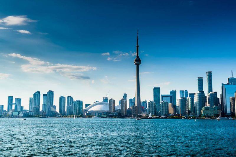 Ontario skyline and lake and CN tower | permanent residence in Canada
