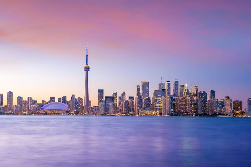 Purple and pink hues on Toronto skyline at sunset in Canada | how to immigrate to Canada from Turkey