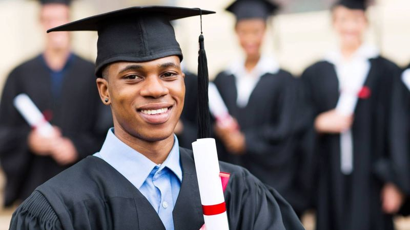 Smiling-African-male-student-at-graduation-ceremony | immigrate to Canada