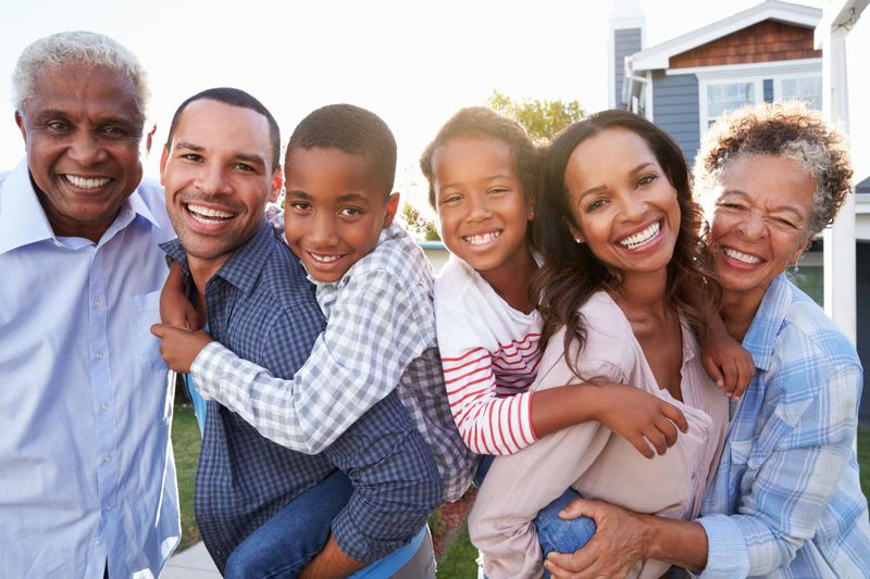 smiling happy extended family   age limit to migrate to Canada