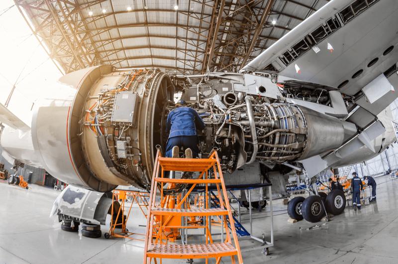 specialist airline mechanic working on passenger plane
