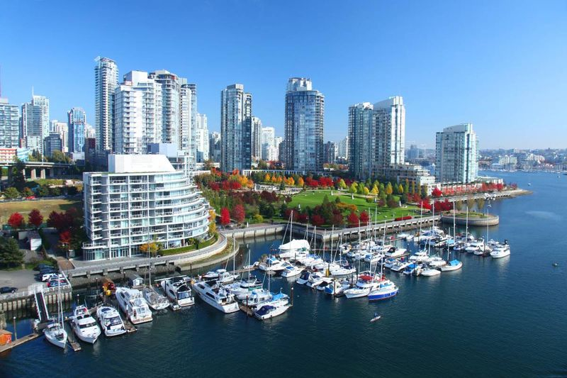 Vancouver British Columbia city on lake with boats   immigrate to Canada