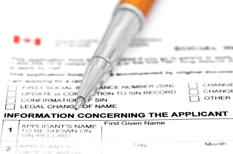 Visa application form with a ballpoint