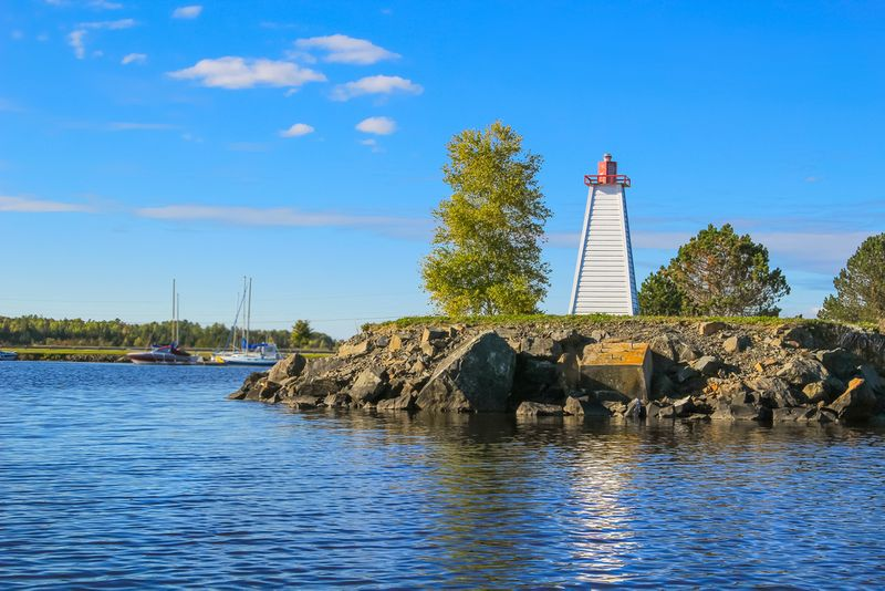 Lighthouse on bank of river in Canada