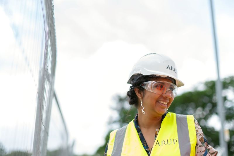 Woman engineer in construction outfit