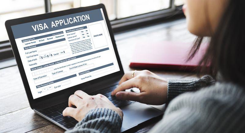 Women applying online on her laptop for her Canadian visa